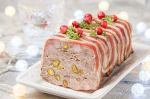 pork terrina with cranberries all wrapped in a smoked becon
